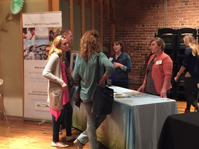 """Volunteers LaVell Winsor (left) and Laura Handke (right) chat with guests at the """"Sip and Shop"""" event during Go Blog Social Apr. 3."""