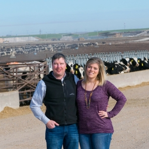 Aly and TJ McClure operate a dairy heifer replacement feed yard in western KS in partnership with family.
